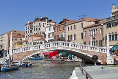 Guglie bridge over Cannaregio Canal in Venice, Italy. Royalty Free Stock Photo