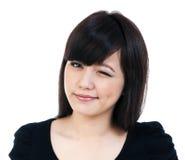 Guiño asiático joven lindo de la mujer Fotografía de archivo libre de regalías
