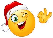Guiño del emoticon con el sombrero de Santa ilustración del vector
