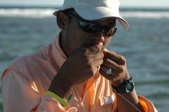 Guia do Honduran que anexa a mosca com dentes foto de stock royalty free