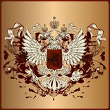 Águia heráldica com armadura, bandeira, coroa e fitas em vi real Fotografia de Stock Royalty Free
