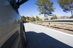 Guida di veicoli all'alta velocità Fotografia Stock