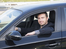 Guida di veicoli dell'uomo Fotografia Stock