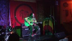 Guidance Band, singing and jams on stage at Mai Tai Bar. Honolulu -   May 11, 2015: Keith Batlin Plays music at the Studio in Hawaiian Brian`s royalty free stock image