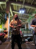 Guidance Band, singing and jams on stage at Mai Tai Bar. Honolulu -  November 8, 2014: Guidance Band, lead singer Keith Batlin, singing and jams on stage at Mai royalty free stock photography