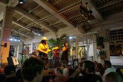 Guidance Band singing and jams on stage at Mai Tai Bar. Honolulu - October 24, 2015: Guidance Band singing and jams on stage at Mai Tai Bar in Ala Moana Shopping stock photography
