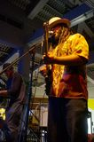 Guidance Band singing and jams on stage at Mai Tai Bar. Honolulu - October 24, 2015: Guidance Band singing and jams on stage at Mai Tai Bar in Ala Moana Shopping stock images