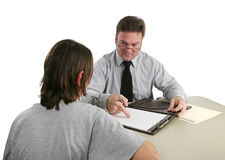 Guidance Counselor - Permanent Record. A guidance counselor sternly pointing to a student's permanent record stock photos