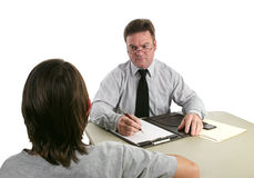 Guidance Counselor - Stern. A guidance counselor sternly talking to a troubled teen royalty free stock photo