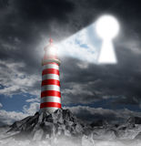 Guidance Key. Business concept with a lighthouse beacon tower shinning a guiding light shaped as a key hole on a stormy dark background sky as a symbol of hope Royalty Free Stock Photo