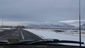 Guidando nella neve Fotografia Stock
