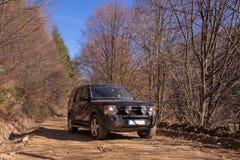 Guidando in un paesaggio di autunno Fotografie Stock