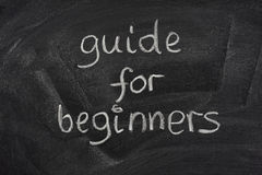 Guide for beginners title on a blackboard Stock Photos