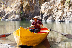 Guide in boat Stock Images