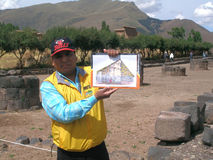Guide demonstrates hypothetical reconstruction of the temple of Wiracocha Stock Photography