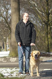 Guide dog is helping a blind man Stock Photos