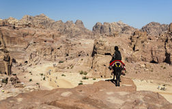 Guide on donkey. Passage to High Place of sacrifice. Petra. Jordan. Royalty Free Stock Photos
