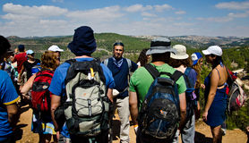 Guide in Jerusalem mountains. Hikers listening to a guide telling them interesting stories on Jerusalem mountains Stock Images