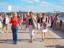 A guide leads a group of tourists. A group of tourists visiting the attractions in St. Petersburg. Russia. The summer of 2017. Royalty Free Stock Image
