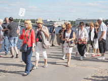 A guide leads a group of tourists. A group of tourists visiting the attractions in St. Petersburg. Russia. The summer of 2017. Royalty Free Stock Photography
