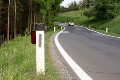 Guide Post on a Country Road. Car that is traveling on a country road Royalty Free Stock Images