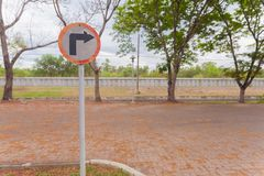 Don`t turn right.sign on pole in the park. Guide post,don`t turn right.sign on pole in the park royalty free stock images