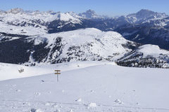Guide post on snow, Corvara Stock Photography