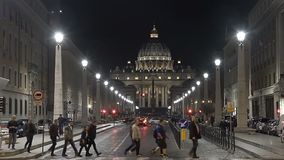Guide showing tourists Vatican city and famous St. Peter's Basilica, crosswalk. Stock footage stock footage