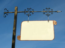 Guide sign. Fine empty sign arrow with blue sky Stock Photos