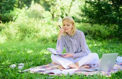 Guide starting freelance career. Become successful freelancer. Woman with laptop sit on rug grass meadow. Girl with. Notepad write note. Business lady freelance stock image