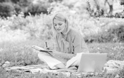 Guide starting freelance career. Business lady freelance work outdoors. Become successful freelancer. Woman with laptop. Sit on rug grass meadow. Girl with royalty free stock photography