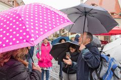 The guide tells the group about the place in which they are in Sibiu city in Romania. Sibiu, Romania, October 07, 2017 : The guide tells the group about the Royalty Free Stock Photos