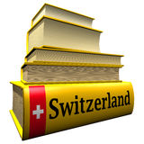 Guidebooks and dictionaries of Switzerland. Yellow guidebooks and dictionaries of Switzerland with flag Royalty Free Stock Images