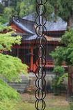 Guided Rain. Rain running down a chain link guide at a Buddhist Temple in Kyoto Japan Stock Image