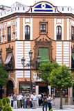 Guided tour tourists through center Seville, Spain. Spain, Sevilla Province, Andalusia, Seville, a group of holiday makers take a walking tour led by a guide stock photo