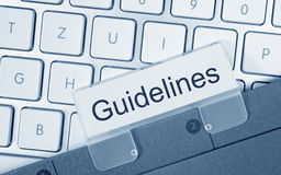 Guidelines - folder with text on computer keyboard. In the office Royalty Free Stock Photos