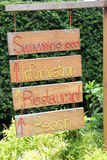 Guidepost for resort. Wooden guidepost for resort near the beach royalty free stock photography