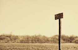 Guidepost in Russian 'Bathing zone'. Sepia Stock Images