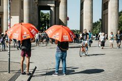 Guides with red umbrellas are waiting for tourists. royalty free stock photos