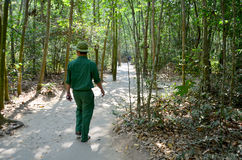Guides vietnamese people lead travel around at Cu Chi tunnels Stock Photos