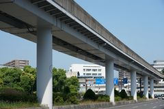 A guideway bus system or guided busway, Yutorito line, track near Ozone station in Nagoya, Japan. Aichi,Japan-June 6, 2019: A guideway bus system or guided stock photography