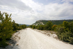 Guidi attraverso le montagne della Crimea Fotografia Stock