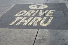 Guidi con la parola sul pavimento di calcestruzzo Immagine Stock Libera da Diritti