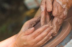 Guiding Hands. This photo is of hands making pottery Stock Images