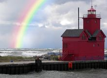 red lighthouse with rainbow Stock Image