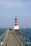 Guiding lighthouse. Walk along the path and ypu will find the lighthouse on the left which guide the boats into land Royalty Free Stock Photos