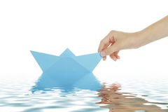 Guiding a paper boat Stock Images