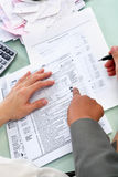 Guiding people to fill tax form Royalty Free Stock Images