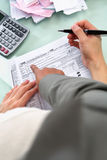 Guiding people to fill tax form Royalty Free Stock Photography