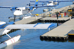 Guiding a Seaplane Out of Its` Dock Stock Images